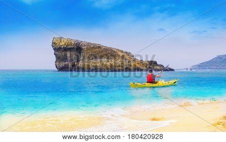 Man rafting on Mediterranean sea near the famous Blue Laggon, Comino island of Malta