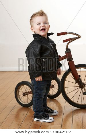 Laughing Toddler With Vintage Tricycle