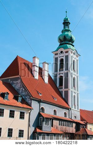 Church in Cesky Krumlov with house in front