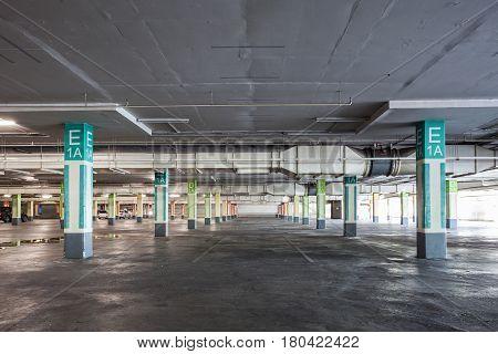 Empty parking garage underground interior in supermarket