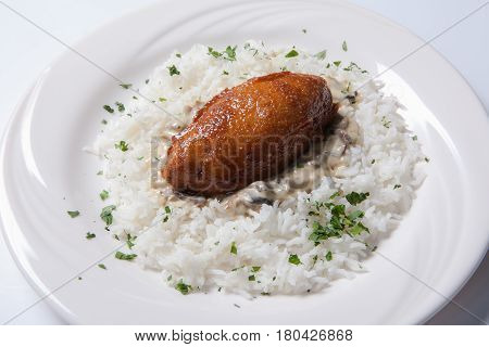 Cordon Bleu With Rice On A White Plate