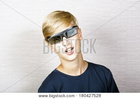 Portrait of smiling blonde boy in 3 D glasses