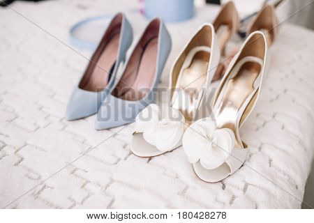 Women's Casual And Luxurious Shoes. Women's Shoes On The Bed. So Many Different Shoes.