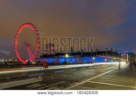 LONDON, ENGLAND - JUNE 16 2016: Night photo of The London Eye and County Hall, Westminster, London, England, Great Britain