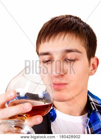 Young Man drinks an Alcohol Isolated on the White Background