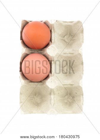 Organic eggs in paperboard egg cartons isolated on white
