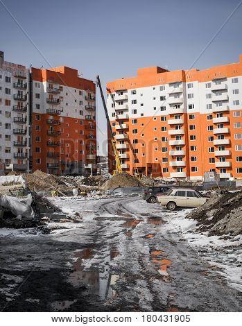 Building under construction, apartment buildings, construction crane, high-rise building, multi storey building