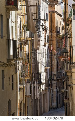 Tarragona (Catalunya Spain): old street in the gothic quarter near the medieval cathedral