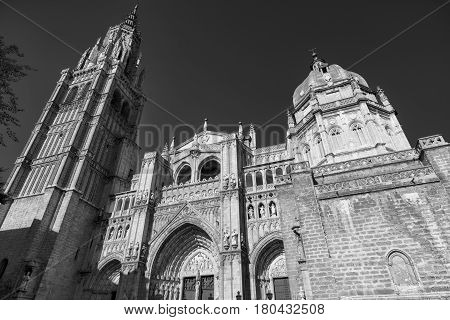 Toledo (Castilla-La Mancha Spain): exterior of the medieval cathedral in gothic style. Black and white
