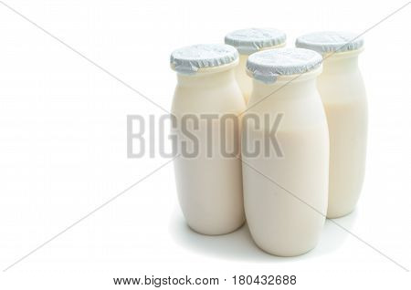 Plastic packaging for sour-milk products on a white background
