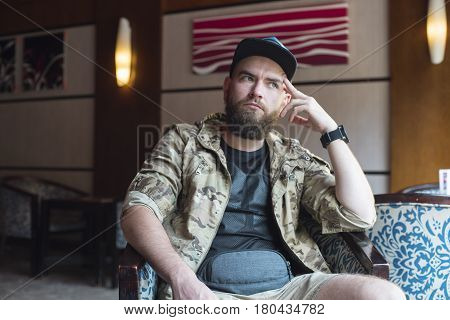 A Bearded Guy. Thoughtful Bearded Guy Indoors.