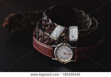 Leather belt with watch and cuff over black
