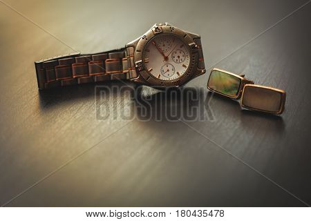 men's accessories. Cuff and watch over grey