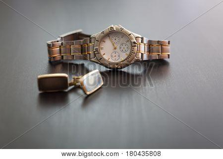 Retro mens wrist watch with cuff over grey