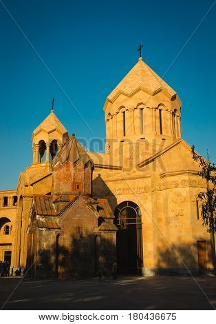 Photo of the Katoghike the oldest surviving church in Yerevan and new religious complex with Saint Anna Church. Architecture concept. City center. Armenia, vertical