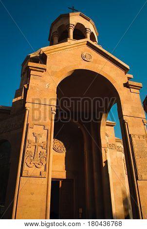 Entry to church. Armenian architecture. Yerevan City center, Armenia. Religious background. Travel concept. Stone khachkar. Ornate exterior.