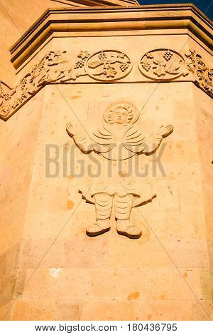 Decoration of external wall Saint Anna Church. Carved figure. Armenian architecture. Yerevan City center, Armenia. Religious background. Exterior concept. Grapevines and foliage ornament