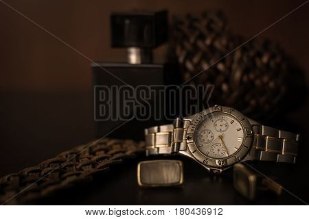 Stylish male accessories. Watch with belt and cuff