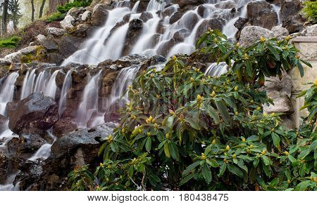 Waterfall with rocks and vegetation in spring