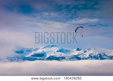 Paraglide Over Snow-capped Peaks