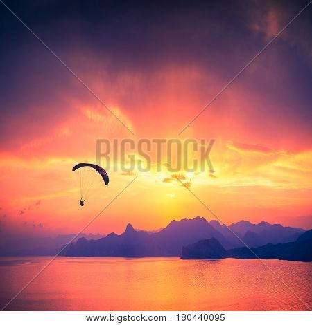 Paraglide Silhouette Over The Sea Sunset