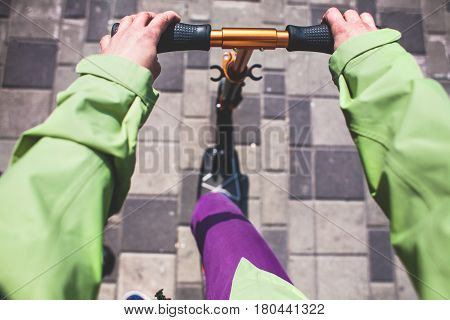Hands On The Wheel Of The Scooter.