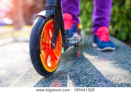 Feet On The Scooter.