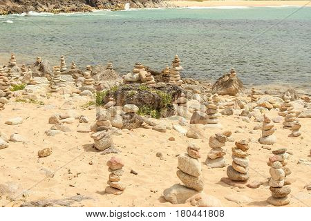 Round Stacked Mystic Stones Laid Out In The Form Of A Pyramid On A Idyllic Spanish Seashore