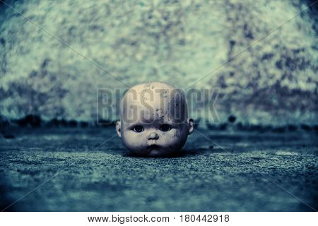 Head of spooky doll in haunted house,Scary background for book cover
