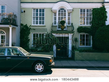 LONDON, UK - FEBRUARY 12, 2016: Old green Bentley parked in front of a house in London.