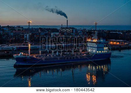 Helsinki Finland - March 31 2017: Bunker vessel Lotus an oil and chemical transport ship moored in port of Helsinki.