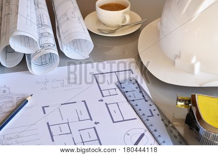 Working Table Of Construction Engineer With Plan Of Project Closeup