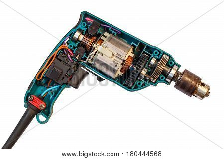 Disassembled electric drill isolated on white background, opened cover showing detail components inside with motor, gears and switch.