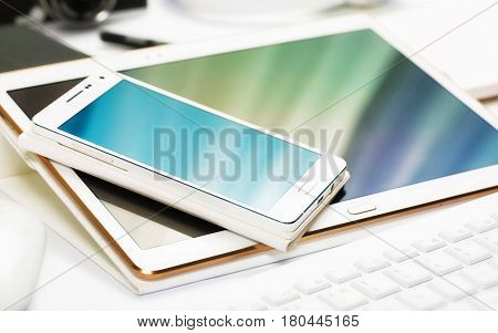Modern electronic devices of white color. Compatible devices
