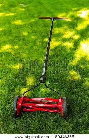 a newly refinished manually powered lawn mover