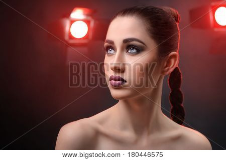 Beauty shot of an attractive young fashion model wearing professional makeup looking away dreamily studio lights on the background copyspace cinema actress fashion stylish glamour cosmetics luxury.