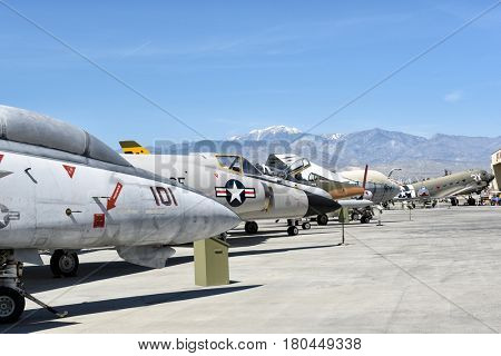PALM SPRINGS, CALIFORNIA - MARCH 24, 2017: A line of vintage war planes at the Palm Springs Air Museum, Palm Springs, California, USA