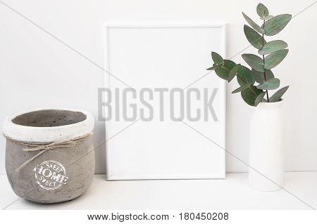 White background frame mockup green eucalyptus in ceramic vase cement pot styled image for social media product marketing blogging