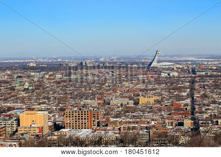 View from top of hill overlooking houses and stadium in the city of Montreal Quebec Canada