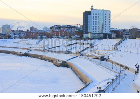Tyumen. Russian Siberia. Sunrise at the Tura Embankment. It is very popular place for resting. It is located in the Central district of city. Everyone may see the historical and cultural places here.