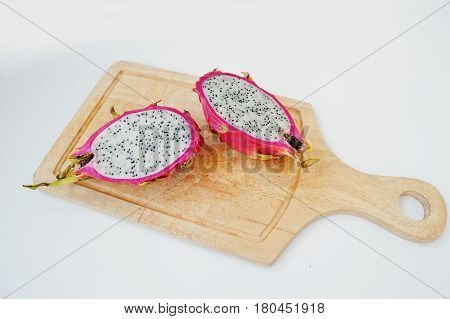 Exotic Fruit Pitaya Or Pitahaya, Dragon Fruit (hylocereus Undatus) On Wooden Board Isolated On White