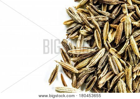 Dry cumin seeds isolated on white. Food background with copy space. Closeup macro shot. Top view.