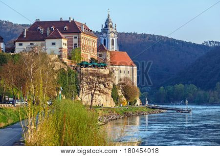 View of the medieval monastery Duernstein on the river Danube in the Wachau valley. Lower Austria