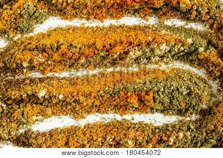 Various colorful spices such as cloves, ginger, chili, turmeric and cinnamon. Food background. Top view.