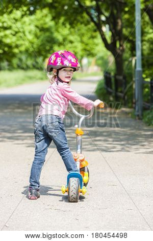 little girl with a scooter