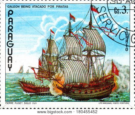 UKRAINE - CIRCA 2017: A postage stamp printed in Paraguai shows Puget galleon pirate ship against from the series Ship painting circa 1976