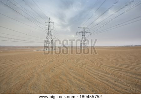 powerlines in a desert near Abu Dhabi