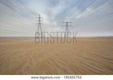 powerlines in a desert near Abu Dhabi