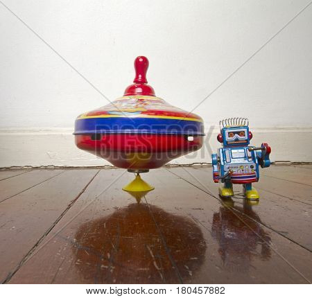 vintage spinning top and mall robot toy