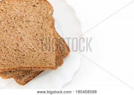 Whole Grain Sandwich Bread Slices On Plate, On White Background.